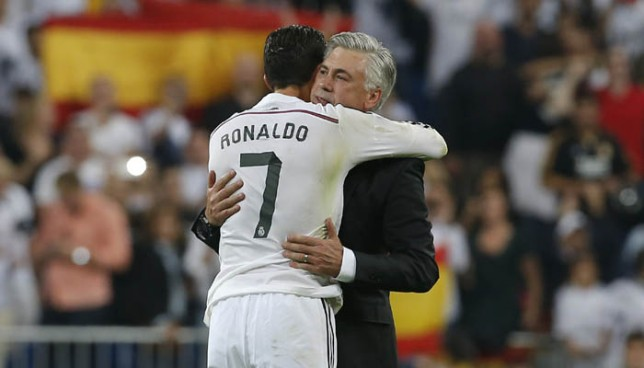 Real Madrid's Cristiano Ronaldo, left, celebrates with Real Madrid's coach Carlo Ancelotti, right, during a Spanish La Liga soccer match between Real Madrid and FC Barcelona at the Santiago Bernabeu stadium in Madrid, Spain, Saturday, Oct. 25, 2014. (AP Photo/Andres Kudacki)